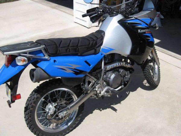 Kawasaki blue motorcycle with seat pad