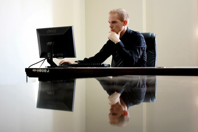 man in office with computer- best chair for programmers